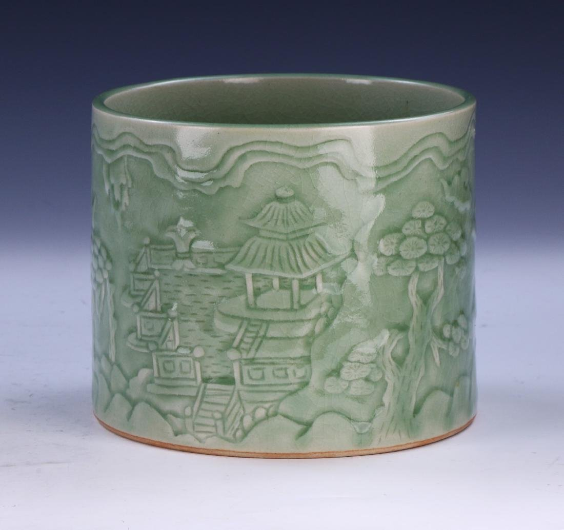 A CHINESE CELADON GLAZED PORCELAIN BRUSH POT