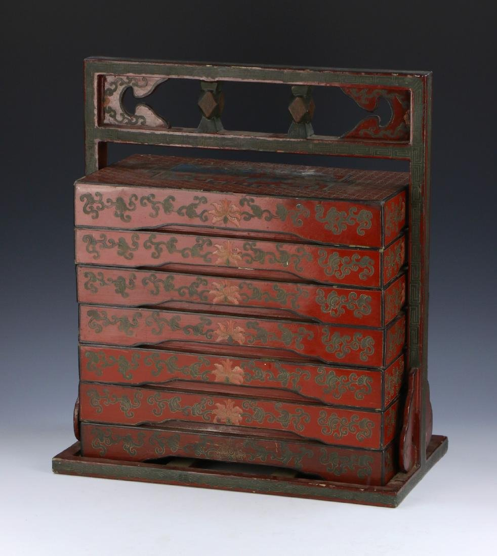 A CHINESE SIX TIERED LACQUER ON WOOD FOOD STORAGE