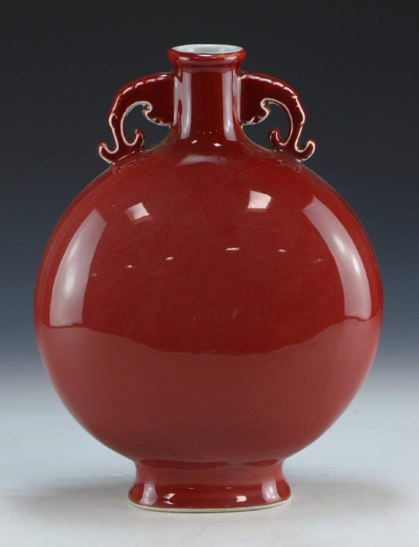 A CHINESE OX BLOOD GLAZED PORCELAIN MOON FLASK