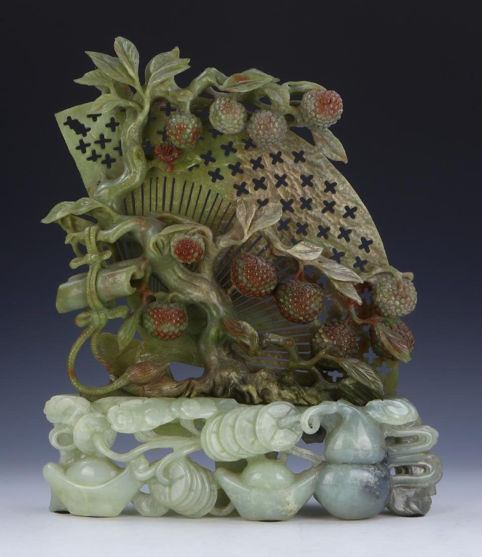 A CHINESE SERPENTINE JADE CARVING