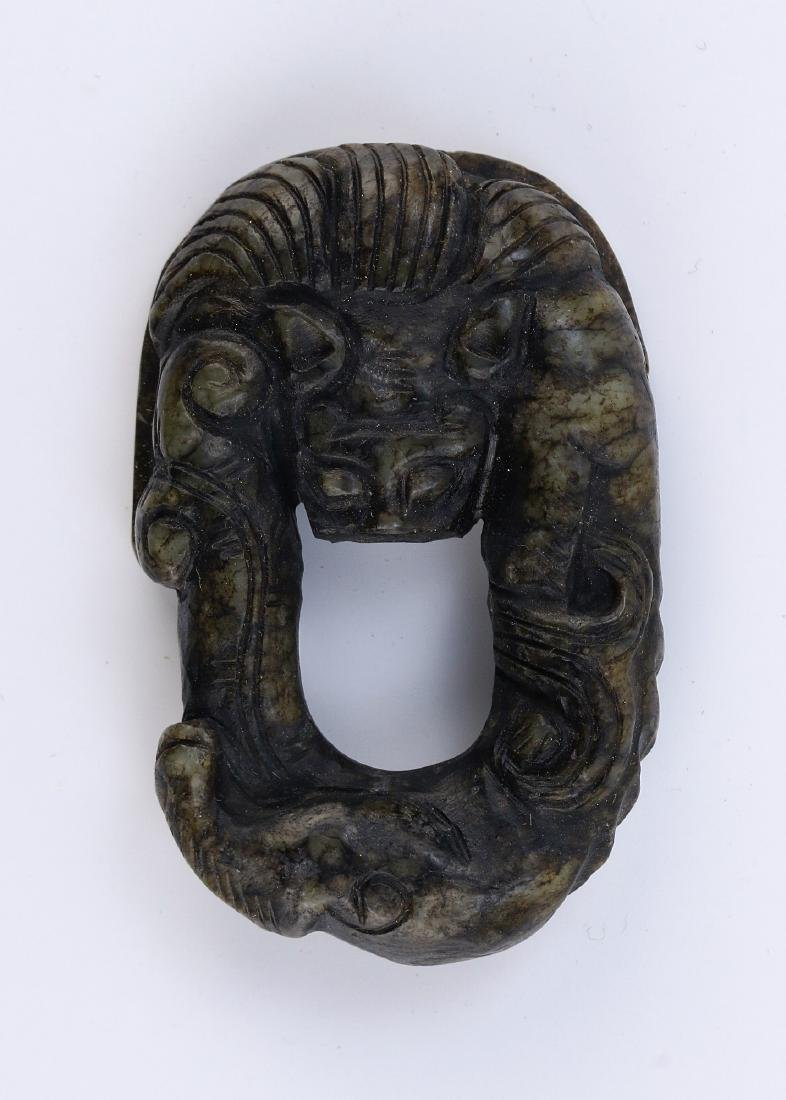 A CHINESE ARCHAIC JADE CARVING