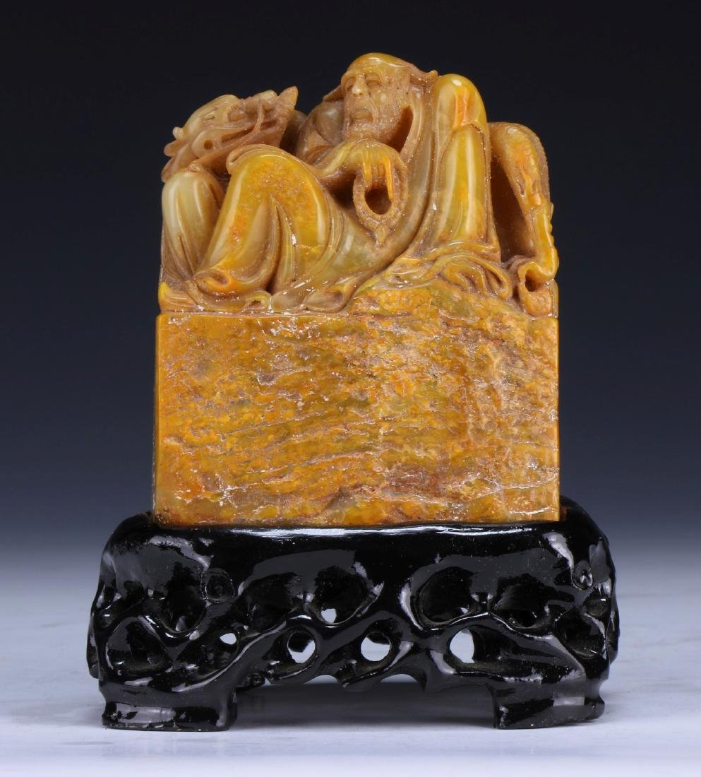 A CHINESE SOAPSTONE FIGURE GROUP