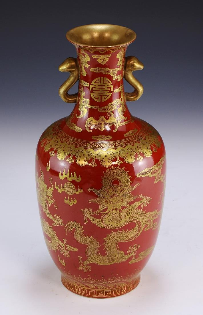 A CHINESE GILT & CORAL RED PORCELAIN VASE