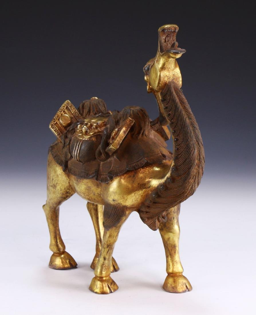 A CHINESE GILT BRONZE CAMEL