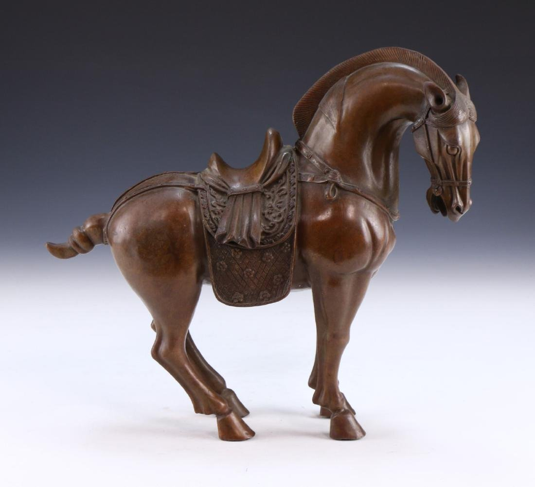 A CHINESE BRONZE HORSE FIGURE