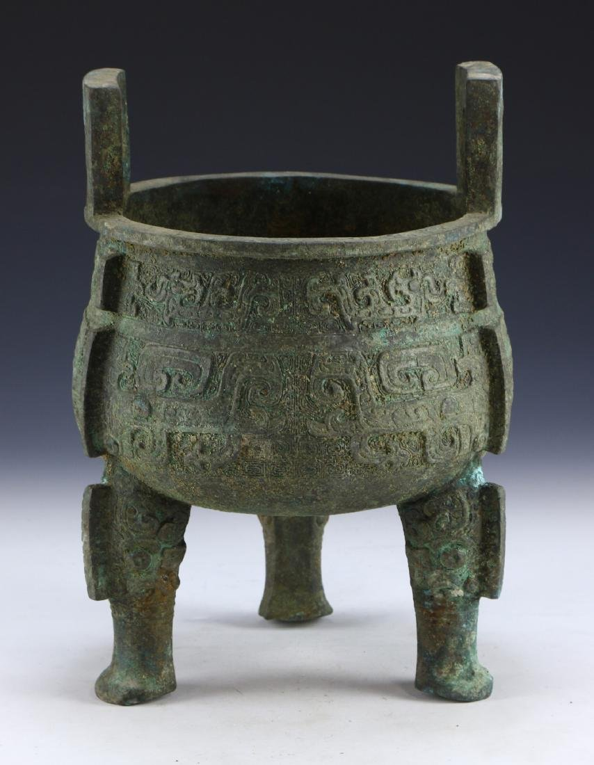 A CHINESE ARCHAIC BRONZE TRIPOD DING