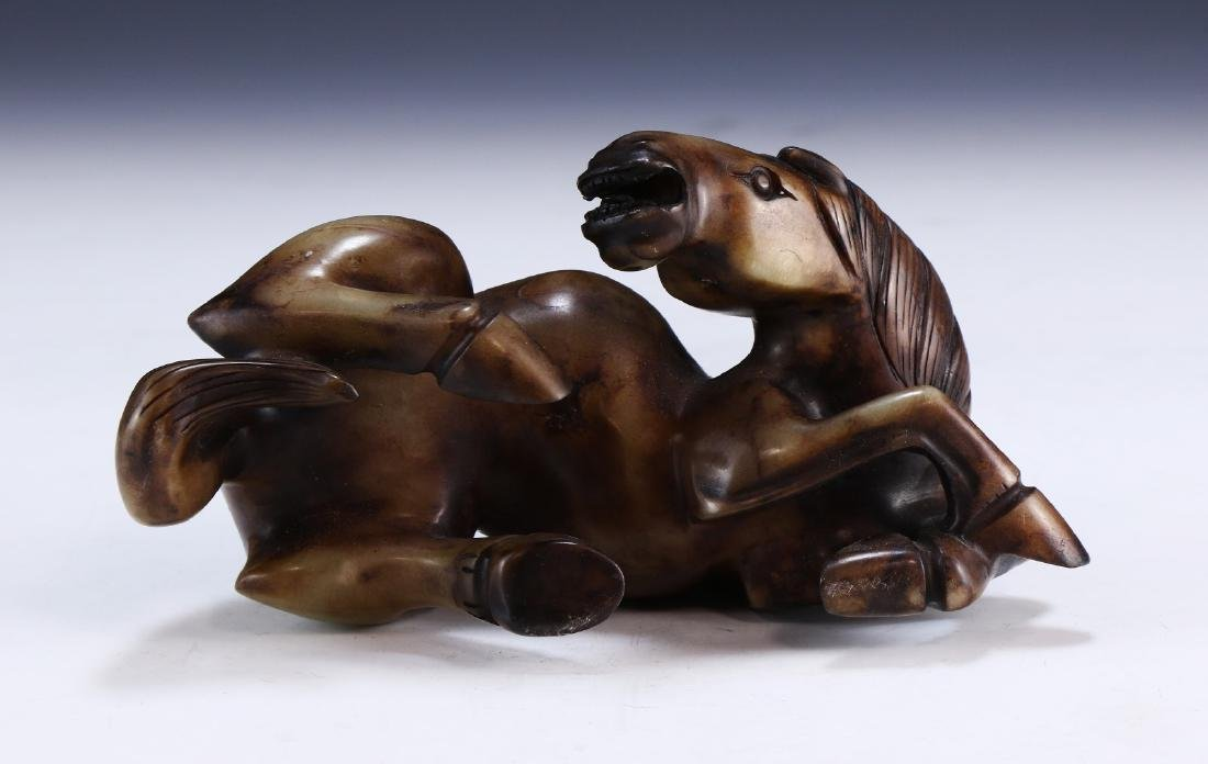 A CHINESE JADE CARVED HORSE