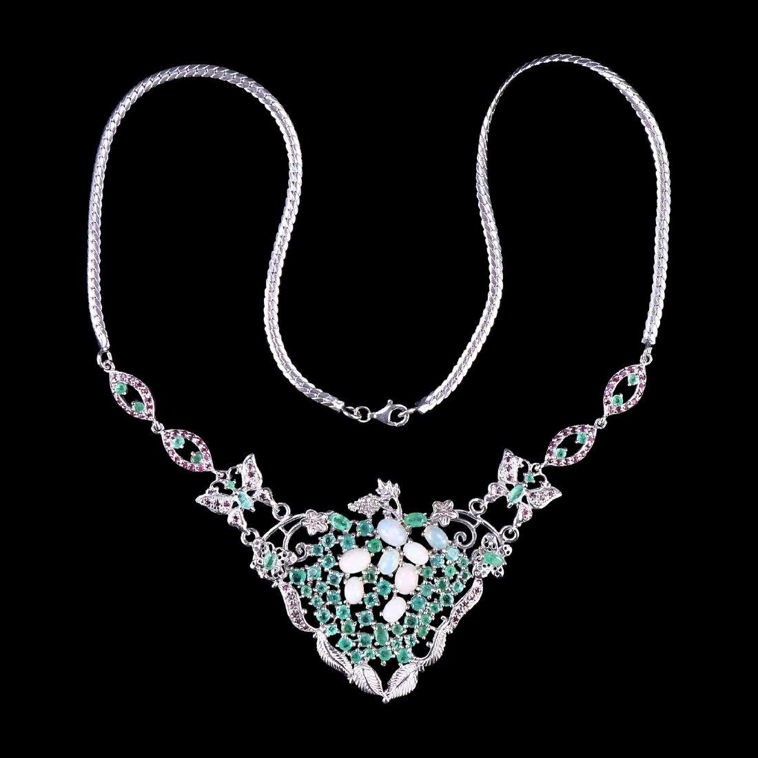 A NATURAL EMERALD, PEARL, & RUBY NECKLACE