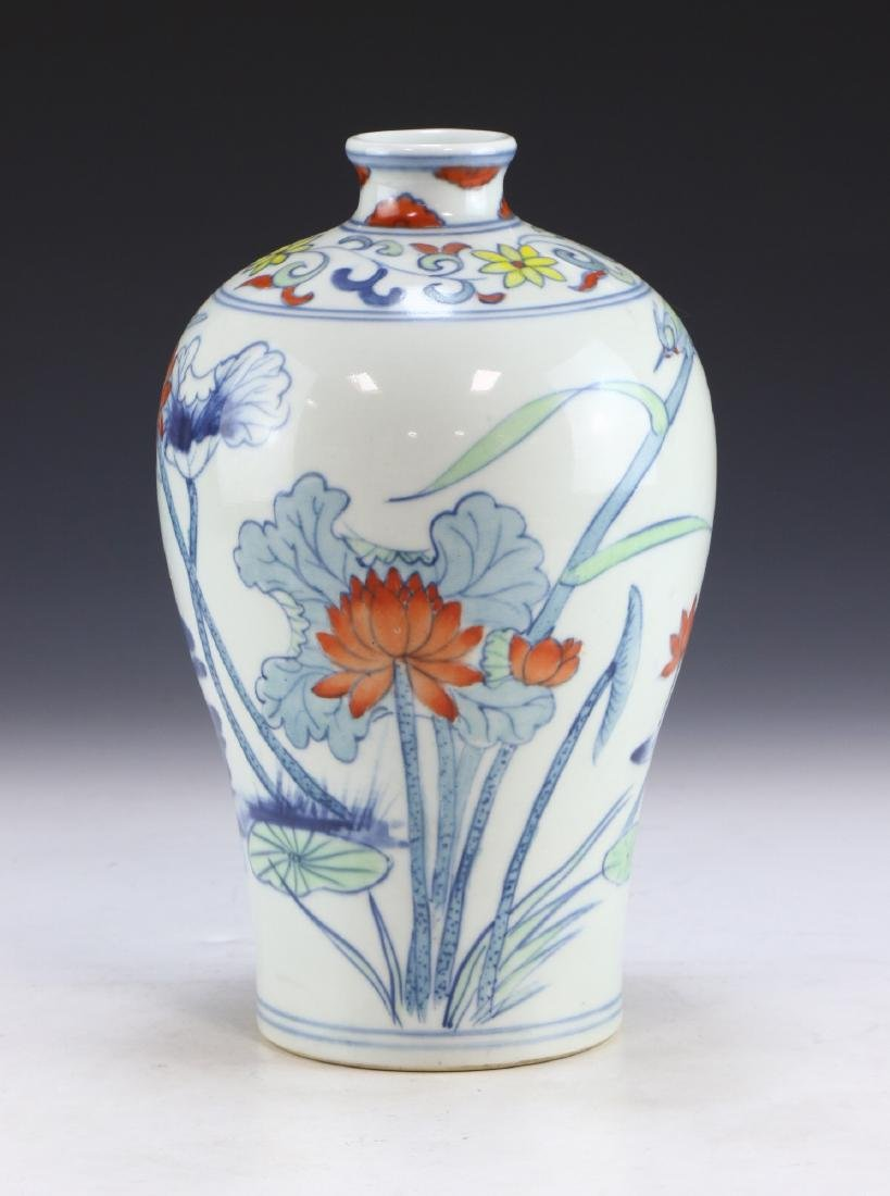 A CHINESE DOUCAI PORCELAIN VASE