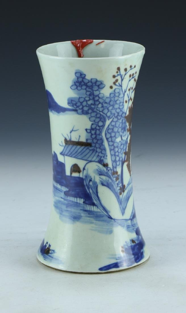 A CHINESE BLUE & WHITE UNDERGLAZED RED PORCELAIN VASE