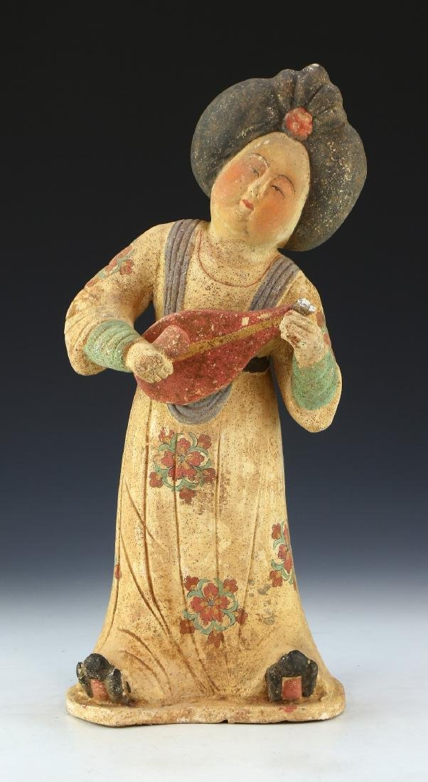 A CHINESE POLYCHROME POTTERY FIGURE