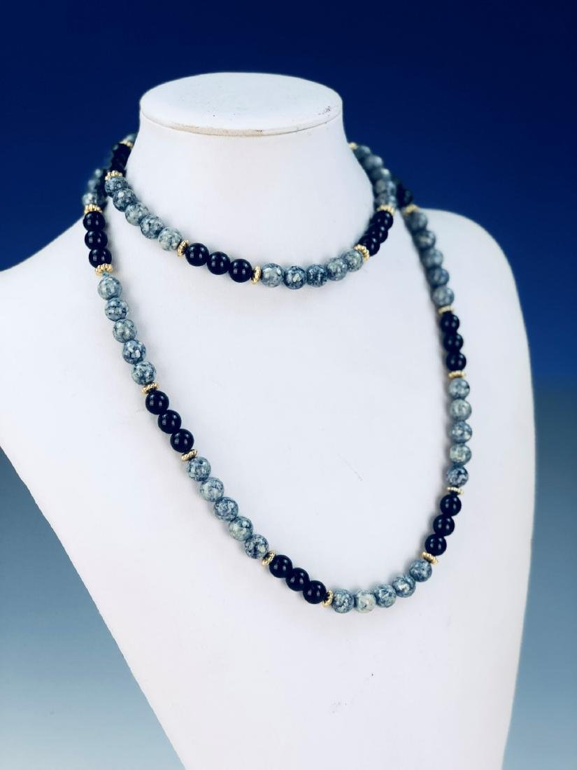 A VINTAGE SPECIOUS STONE BEADED NECKLACE