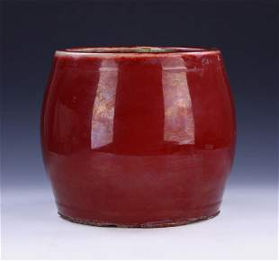 A CHINESE OX BLOOD GLAZED PORCELAIN JAR