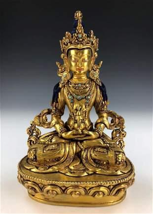 A TIBETAN GILT JEWELED BRONZE FIGURE OF BUDDHA