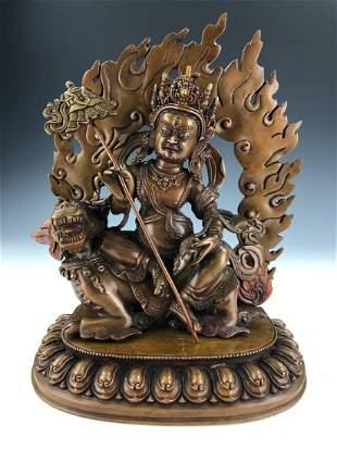 A TIBETAN GILT BRONZE BUDDHA