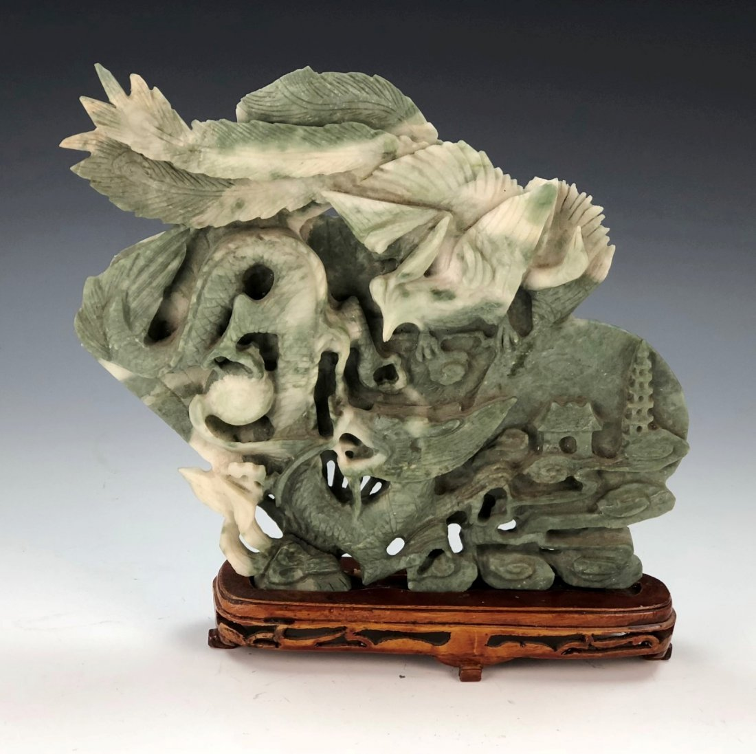 A CHINESE STONE CARVED STATUE