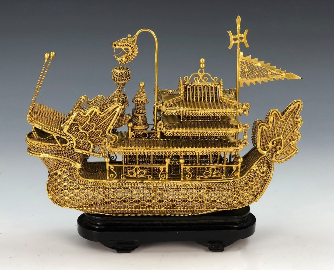 A CHINESE GILT METAL BOAT