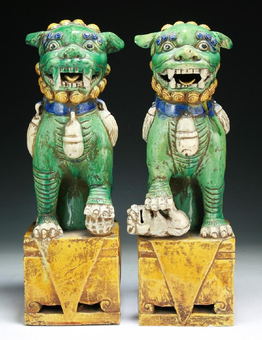 Pair of Chinese Famille Noire Porcelain Lions
