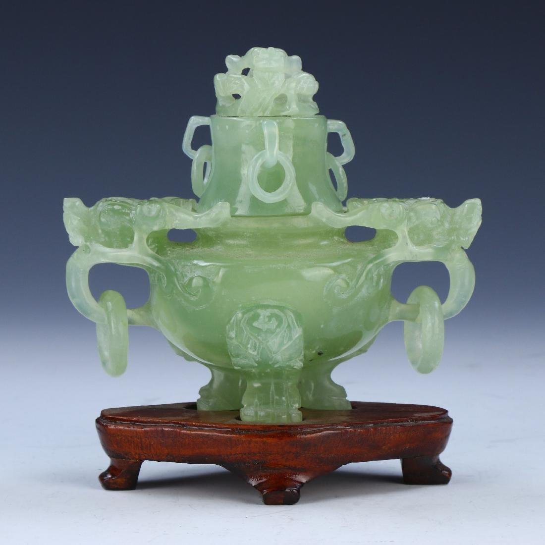 A CHINESE LIDDED SERPENTINE JADE TRIPOD CENSER