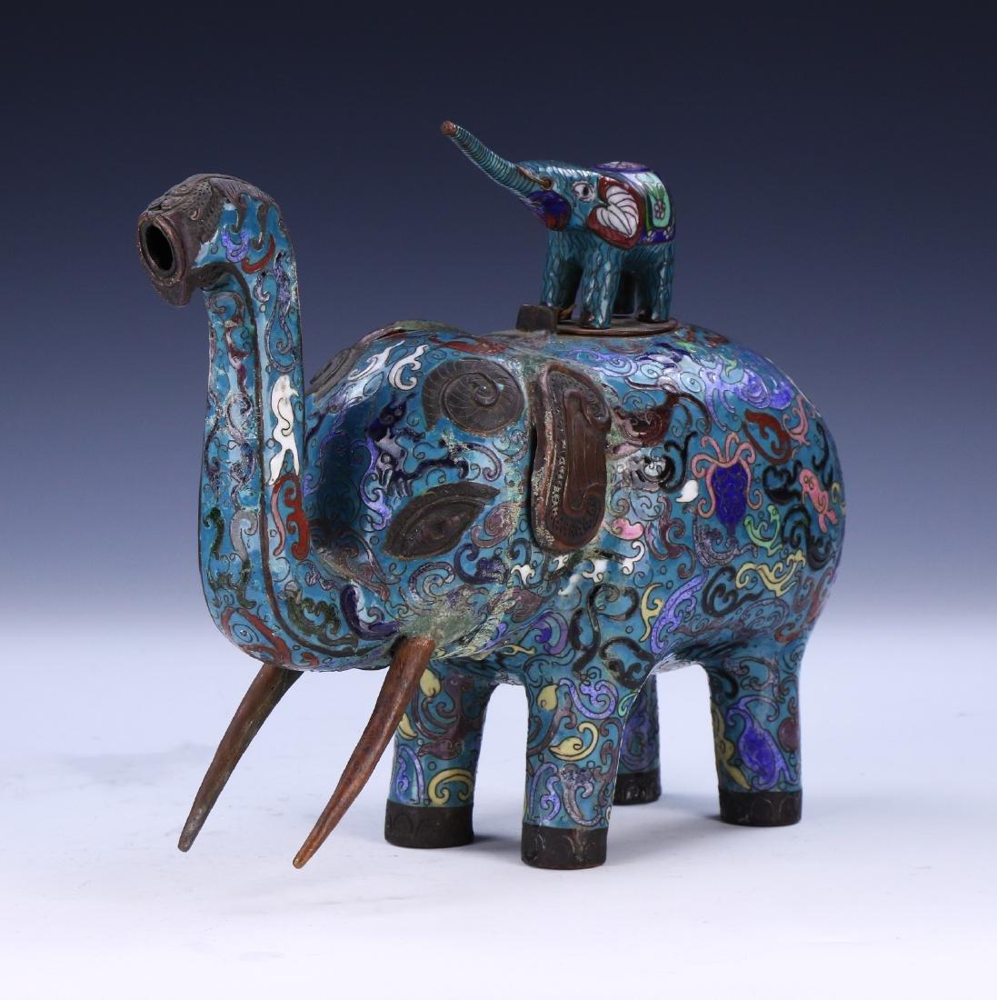 A CHINESE CLOISONNE ENAMEL ELEPHANT