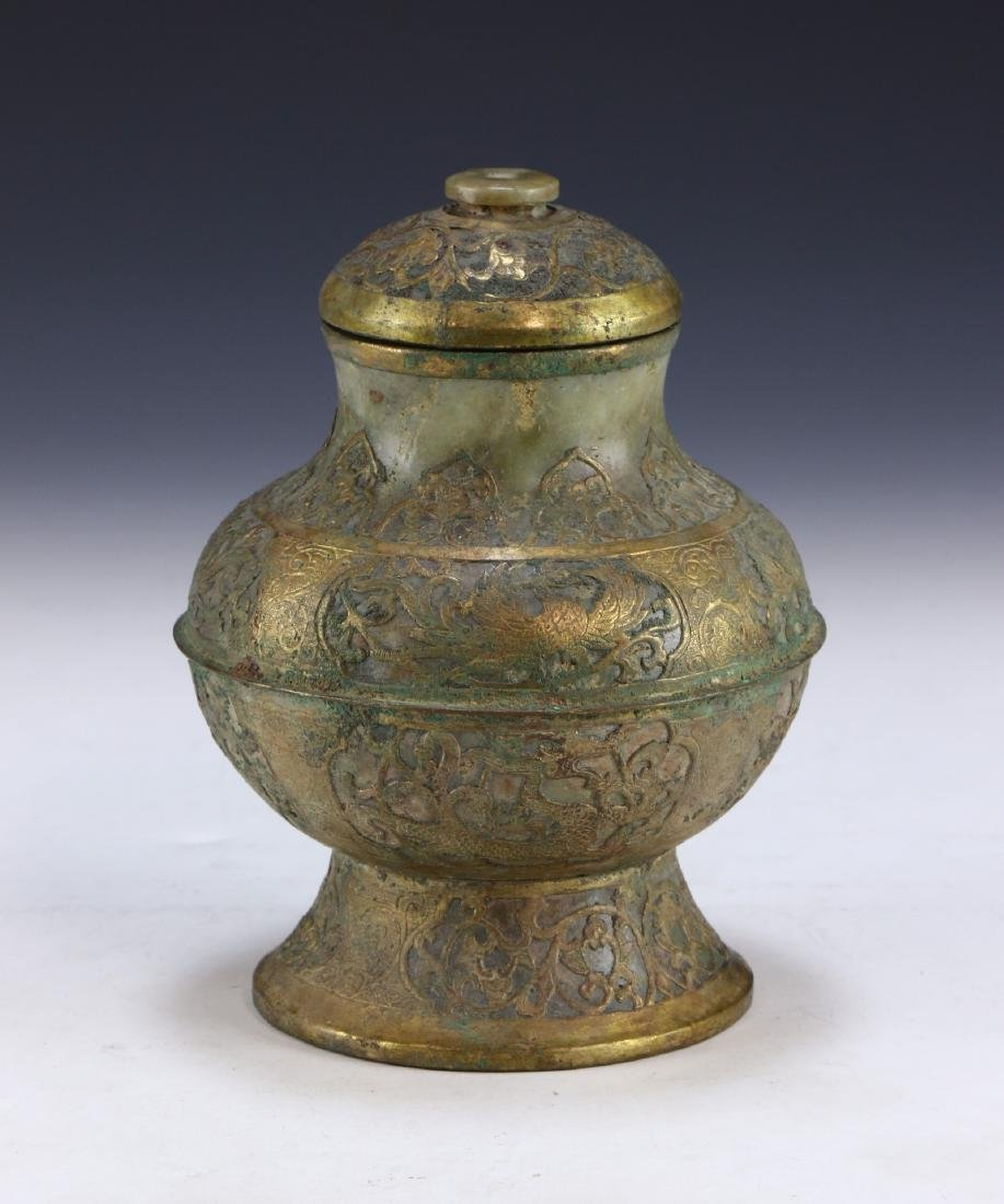 A CHINESE ARCHAIC BRONZE & JADE LIDDED VESSEL