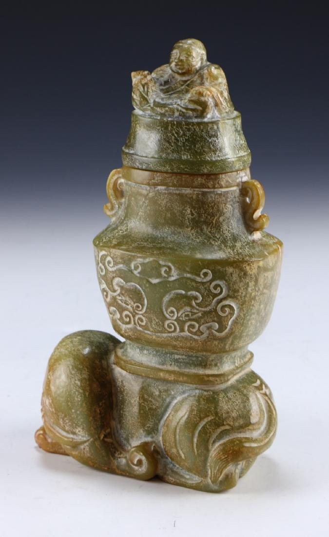 A CHINESE ARCHAIC JADE CARVED LIDDED VASE