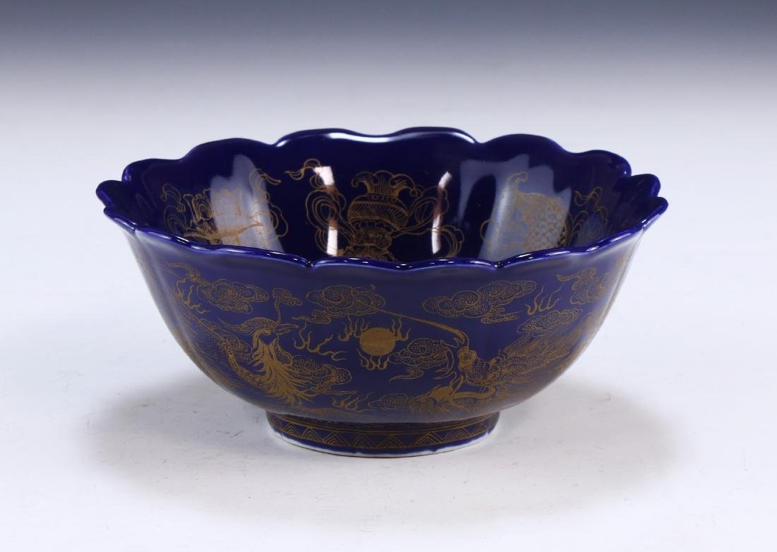 A FINE CHINESE GILT ON BLUE GLAZED PORCELAIN BOWL