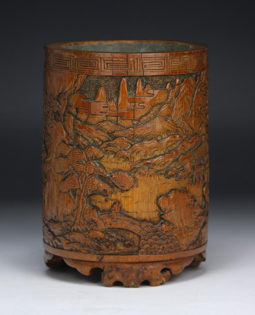 A CHINESE WELL CARVED BAMBOO CARVED BRUSH POT