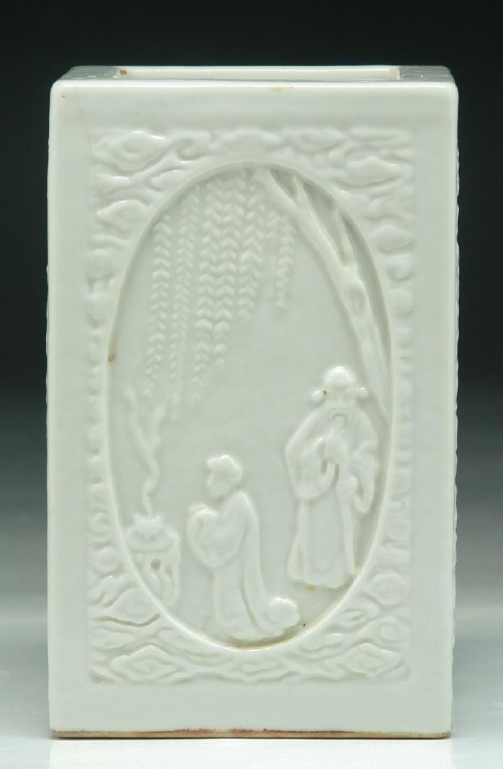 A CHINESE WHITE GLAZED PORCELAIN BRUSH POT
