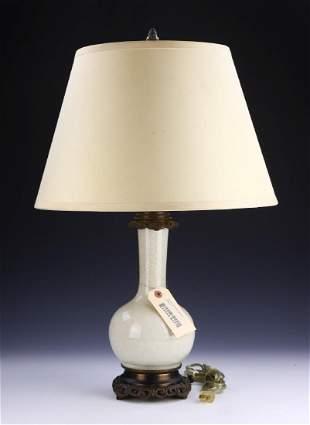 A CHINESE WHITE GLAZED PORCELAIN LAMP