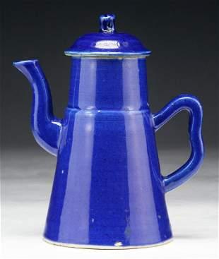 A CHINESE BLUE GLAZED PORCELAIN TEAPOT