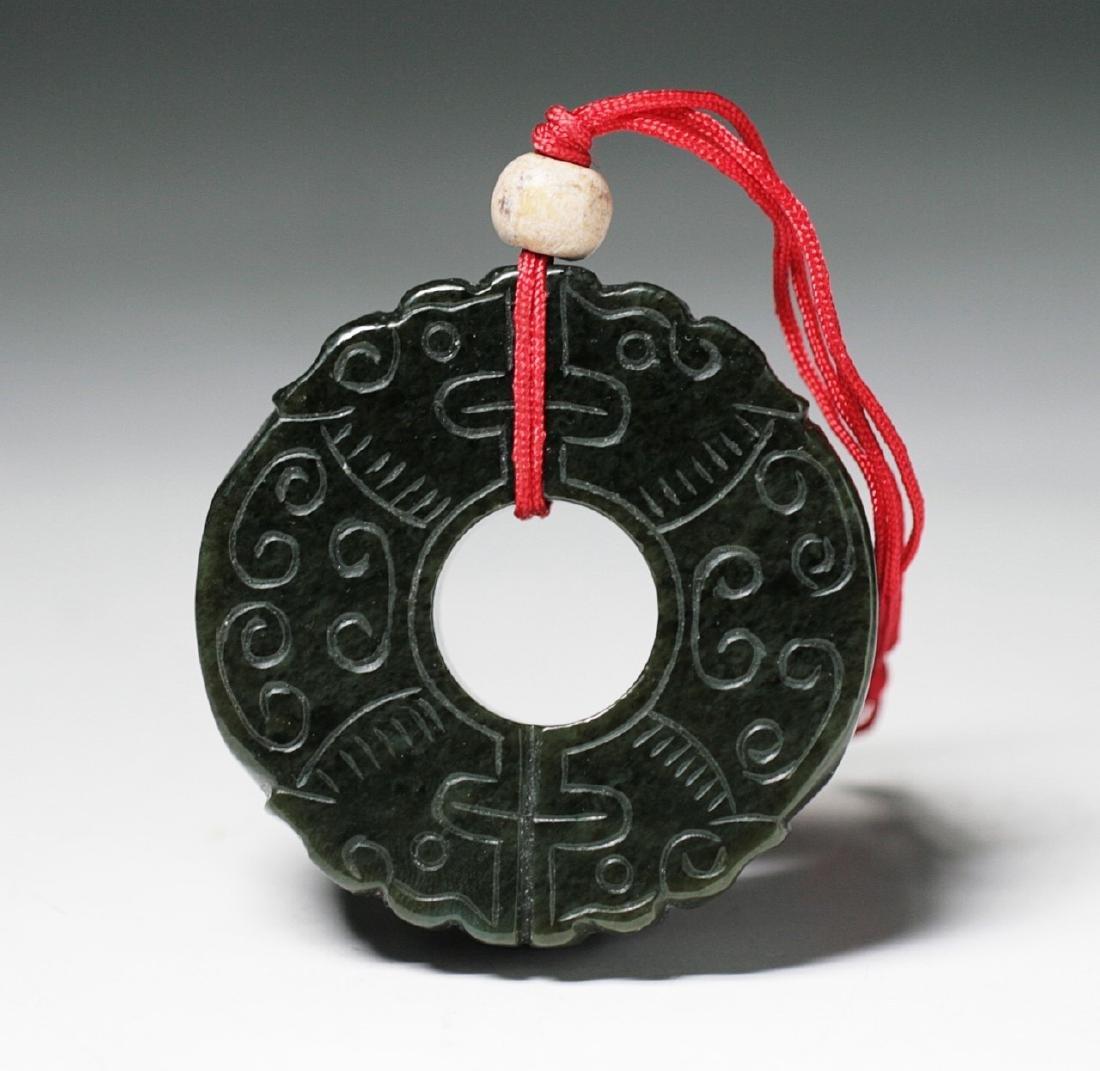 A Chinese Archaic Dark Green Jade Pendant