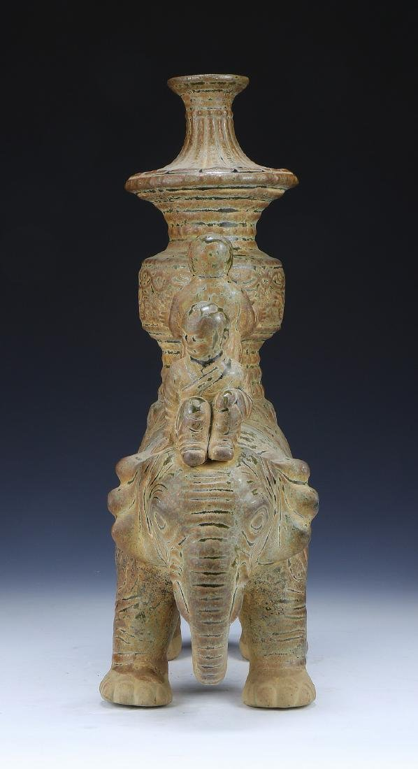 A CHINESE POTTERY FIGURE GROUP - 4