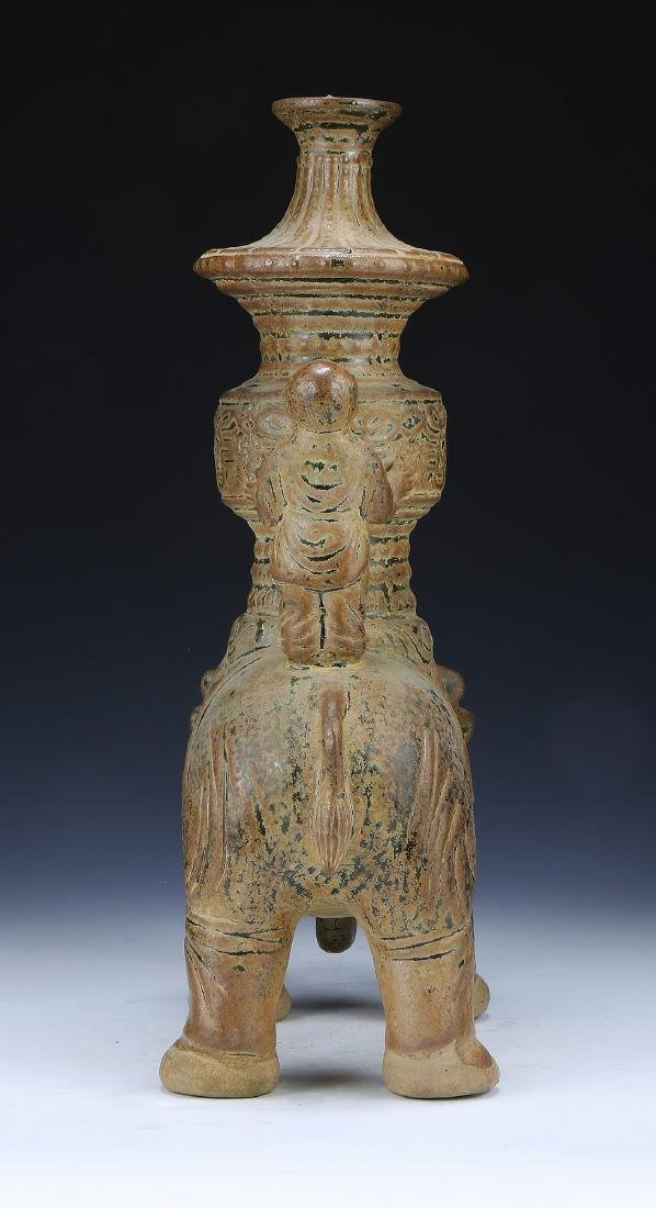 A CHINESE POTTERY FIGURE GROUP - 5