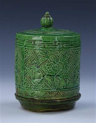 A CHINESE GREEN GLAZED CANDLE HOLDER