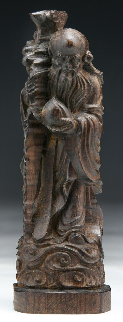 A CHINESE WOOD CARVED FIGURE