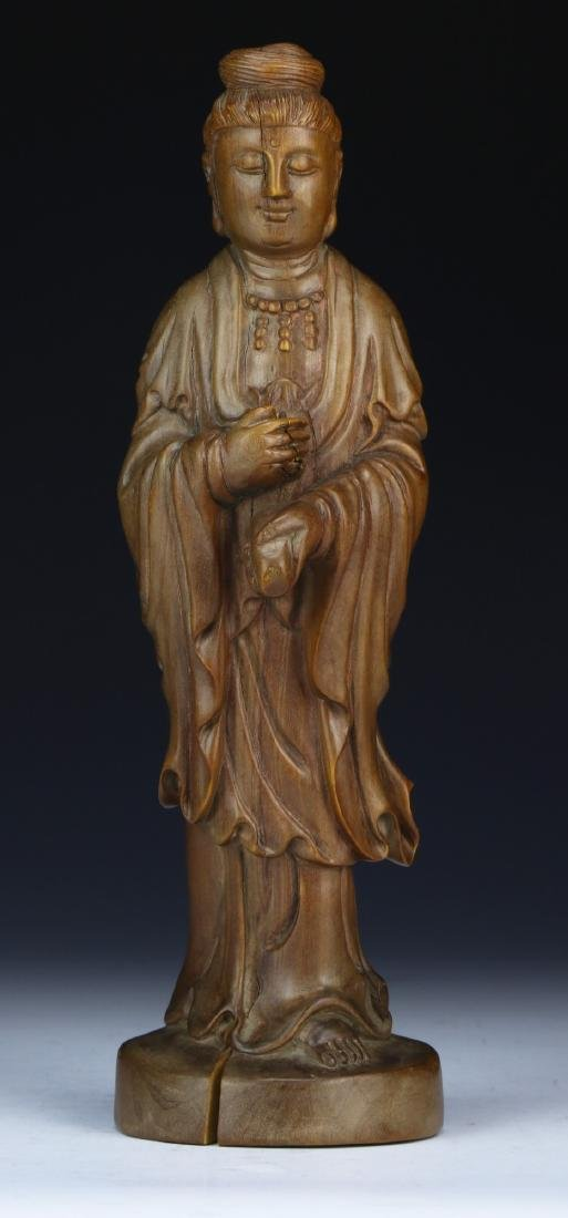 A CHINESE WOOD CARVED GUANYIN