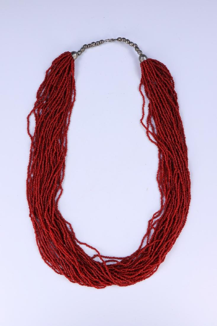 A MULTI-STRAND CORAL BEADED NECKLACE