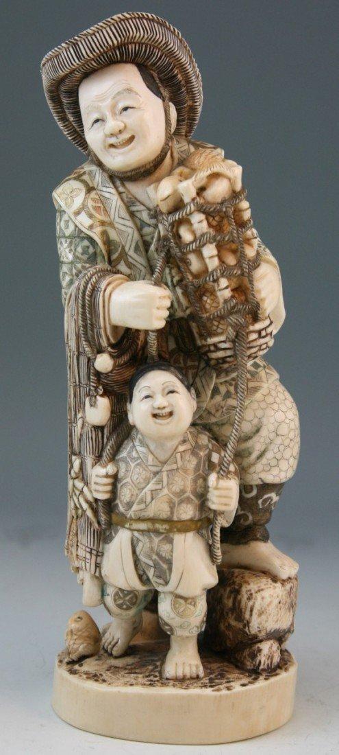 272: Ivory Okimono Group: Man and Child