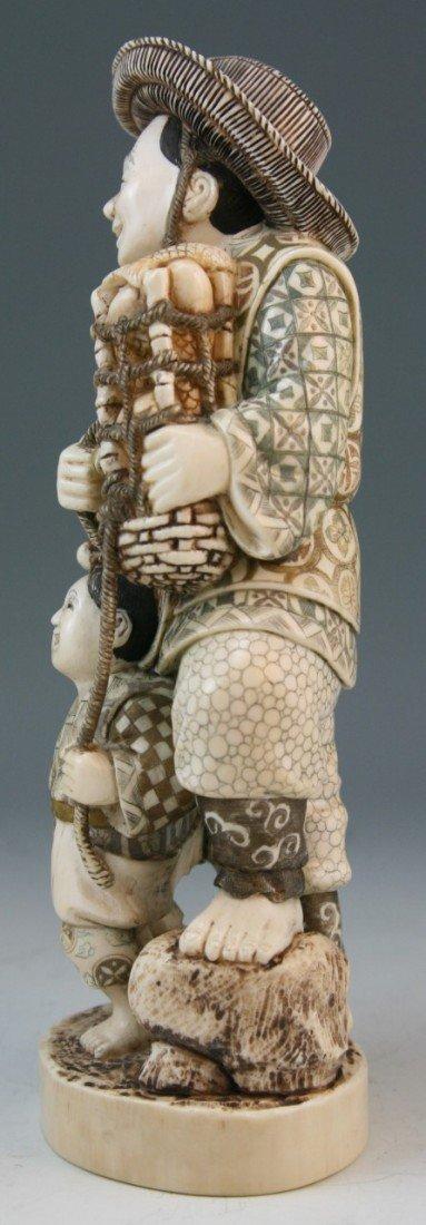 272: Ivory Okimono Group: Man and Child - 2