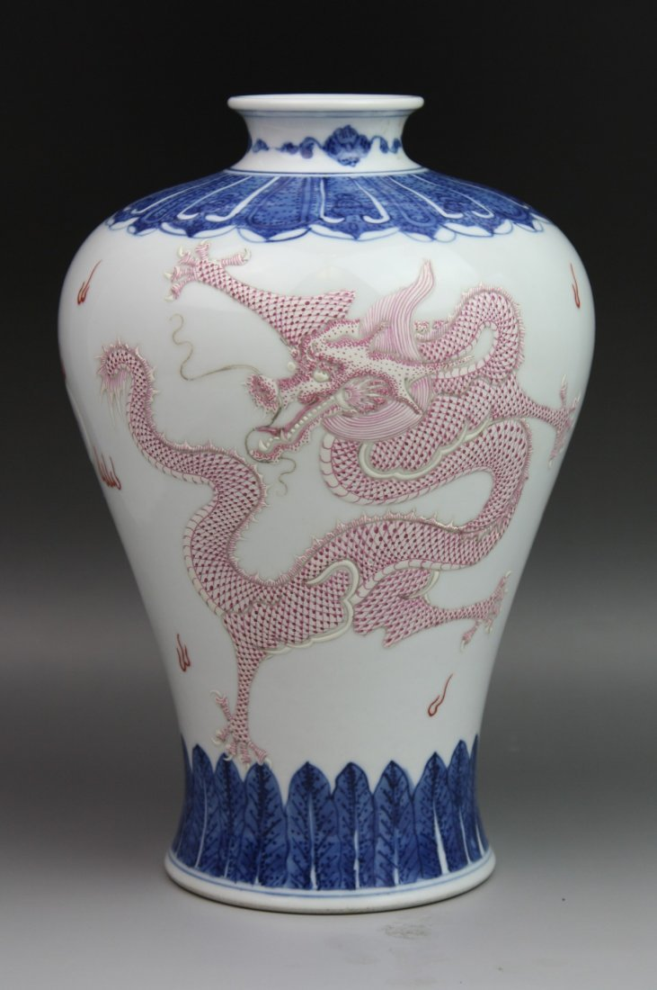 23: A Blue And White Embossed Vase