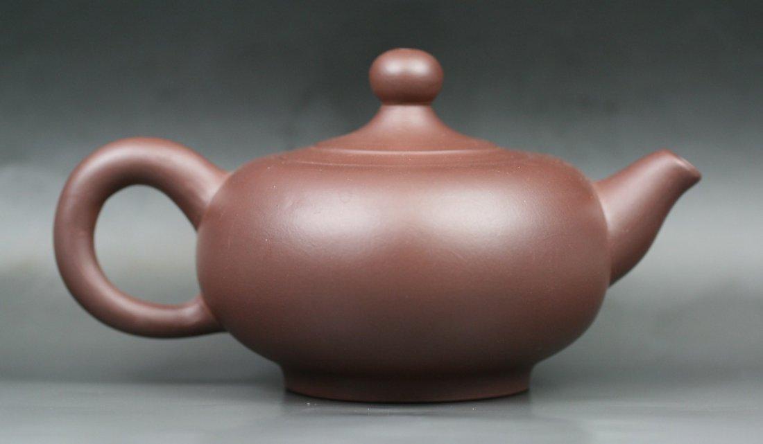 17: A Carved Yixing Purple Clay Zisha Teapot By Xu Hui