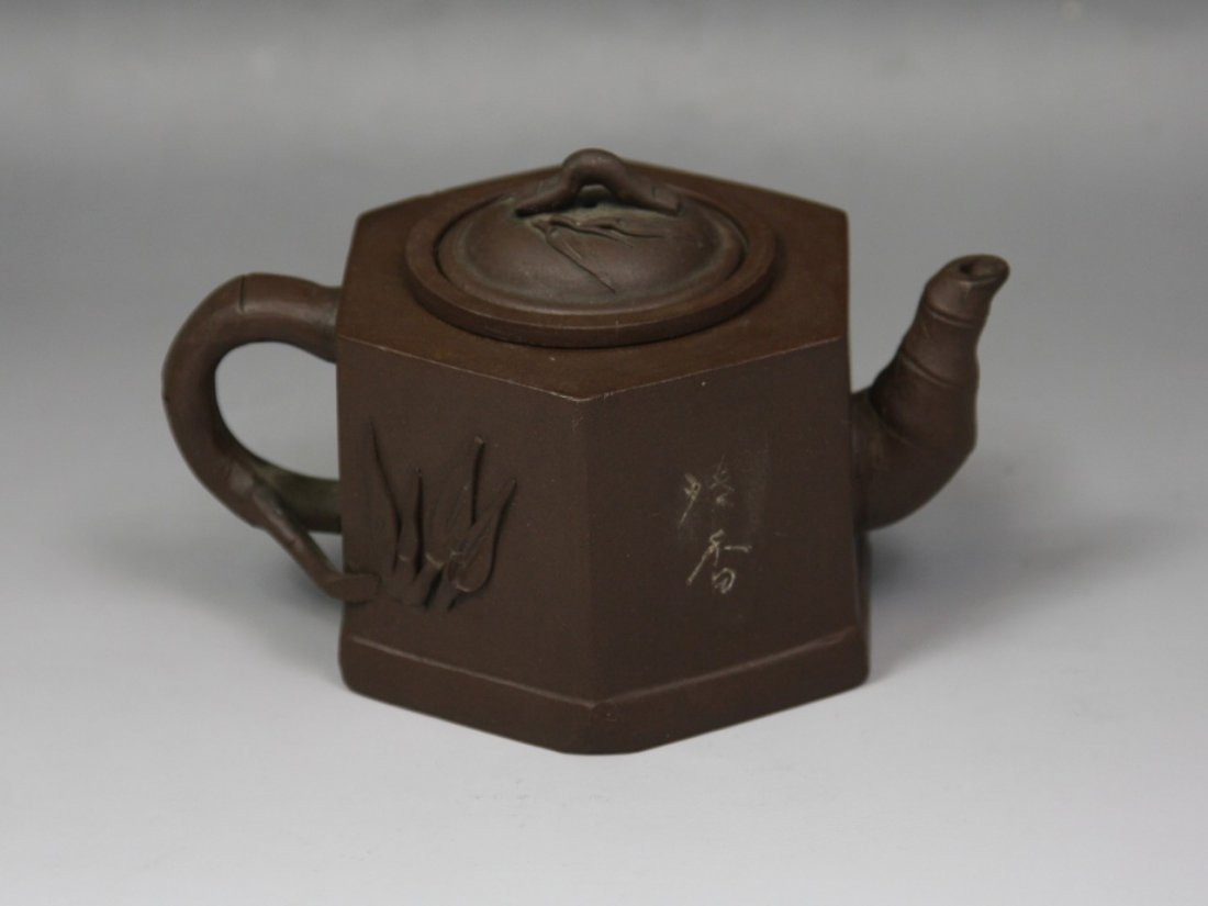 19: A Carved Yixing Teapot And Cover