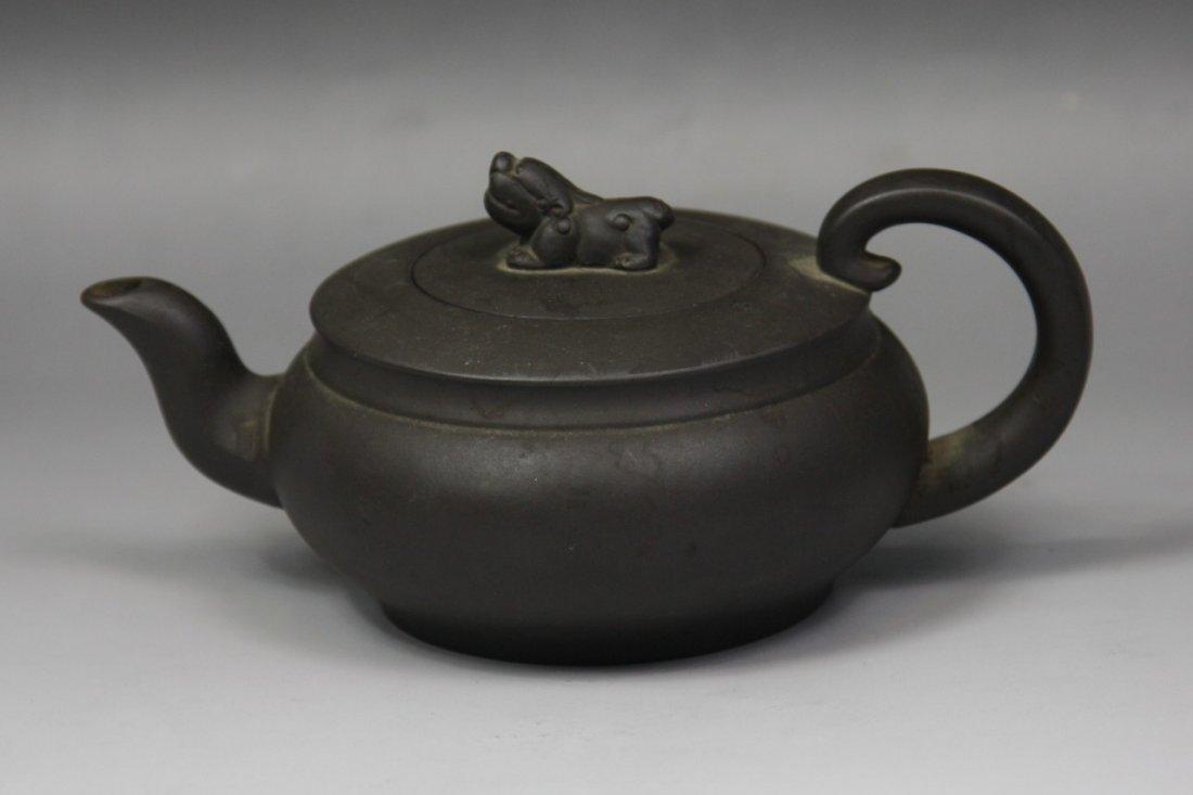 20: A Carved Yixing Zisha Teapot by Song Xuelan