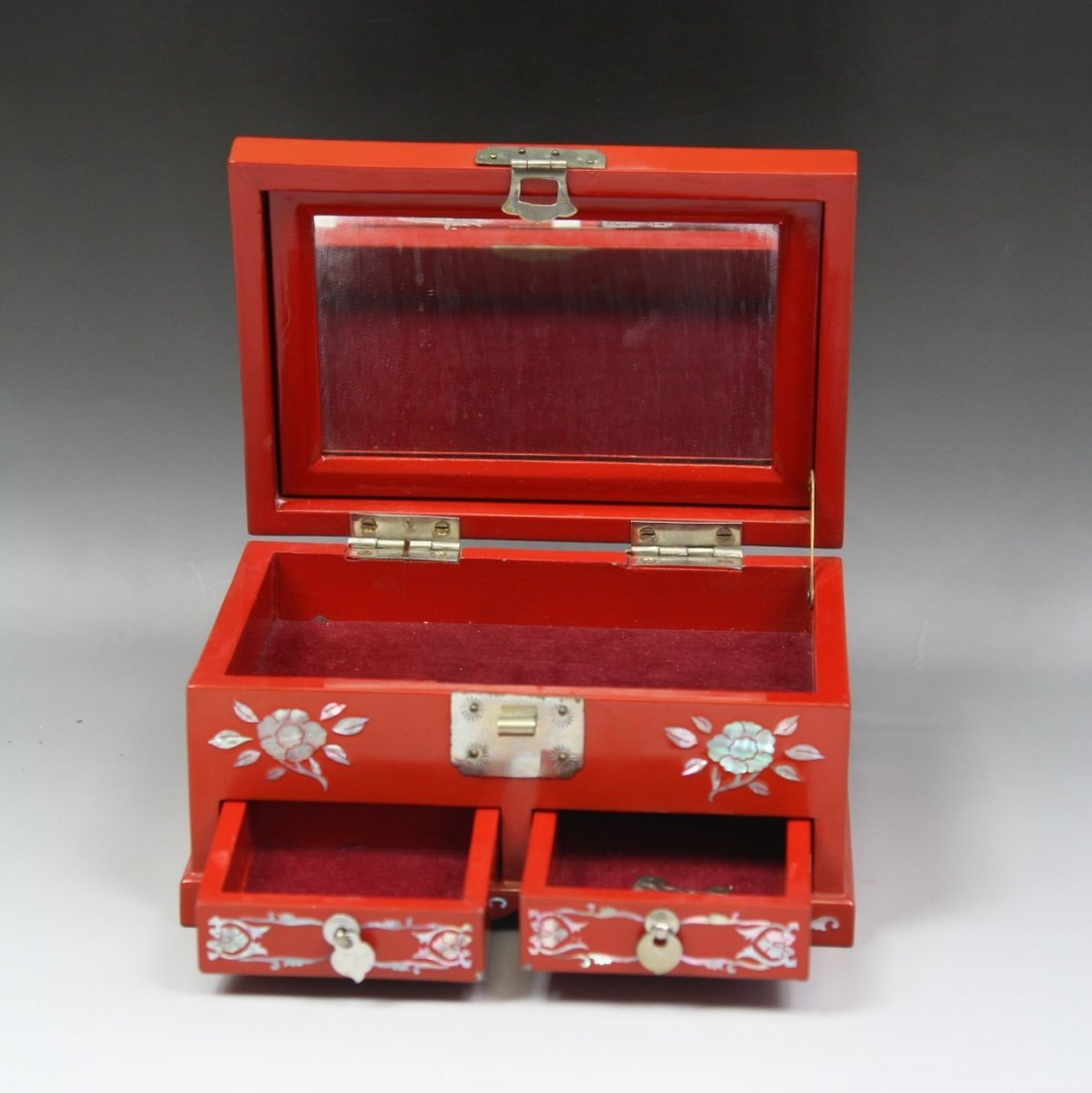 24: A Cinnabar Lacquer Music Box With Mother Of Pearl