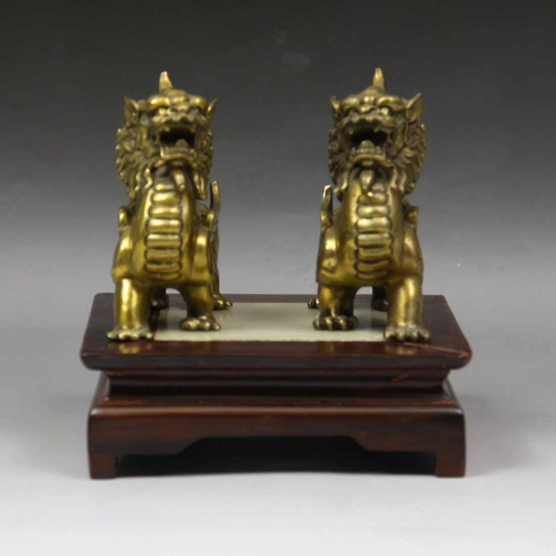 12: A Pair Of Chinese Bronze Kylin With Wood Stand