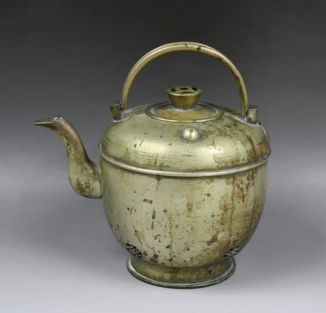 14: A Chinese Antique White Brass Teapot