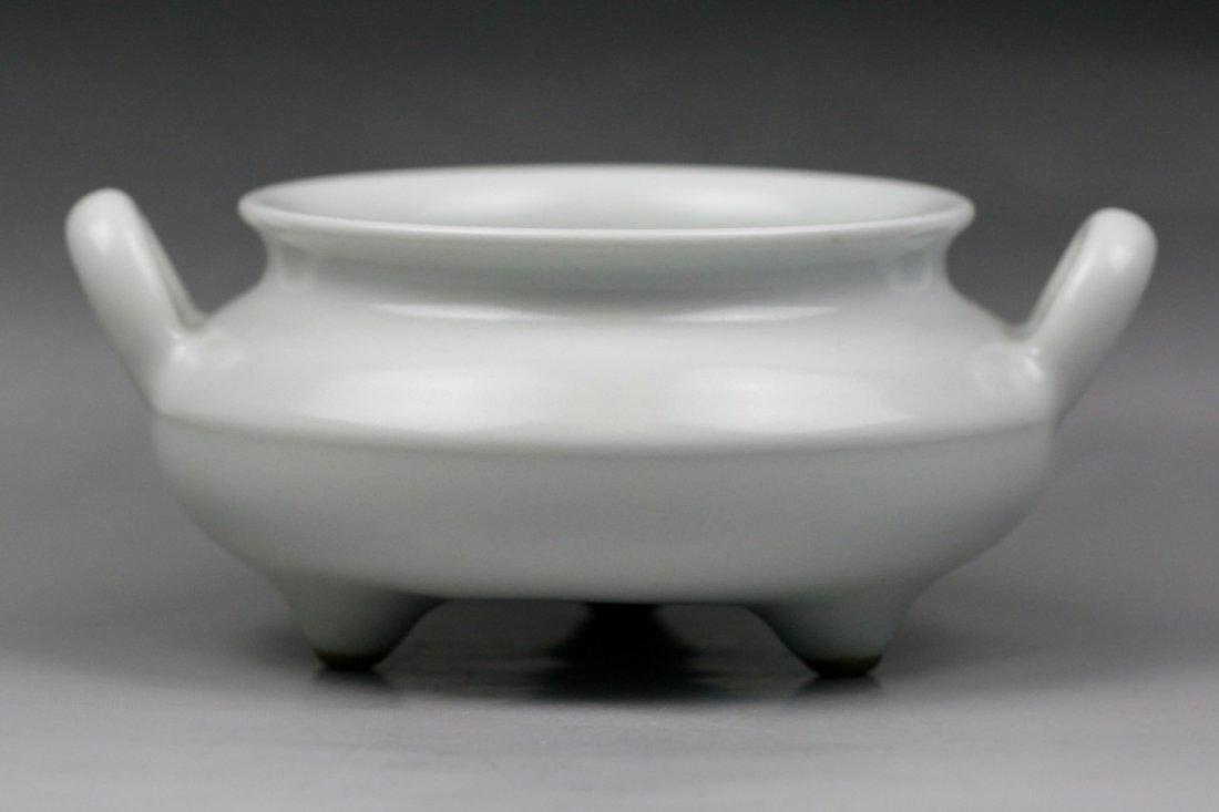 267: A Chinese Qing White Glazed Tripod Censer