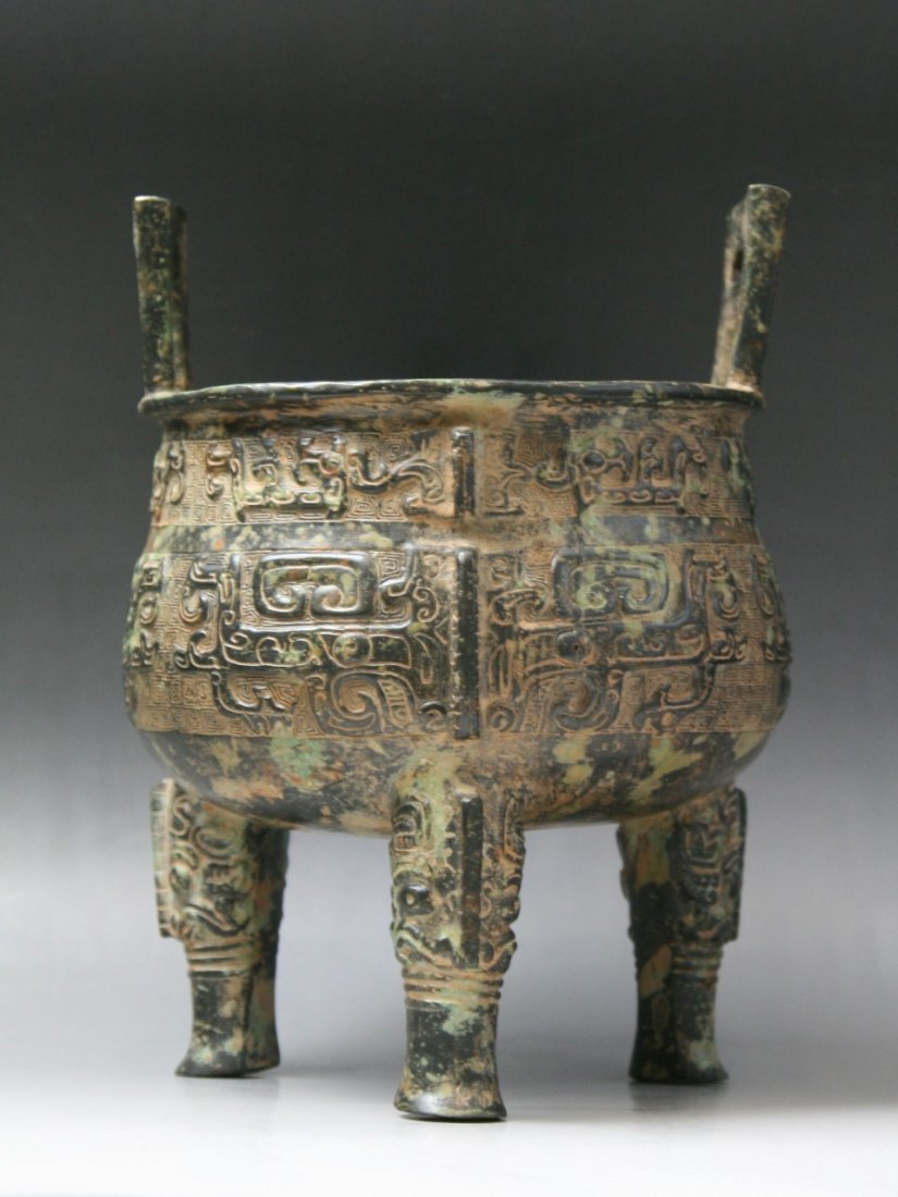 A Chinese Archaic Bronze Tripod Vessel Ding