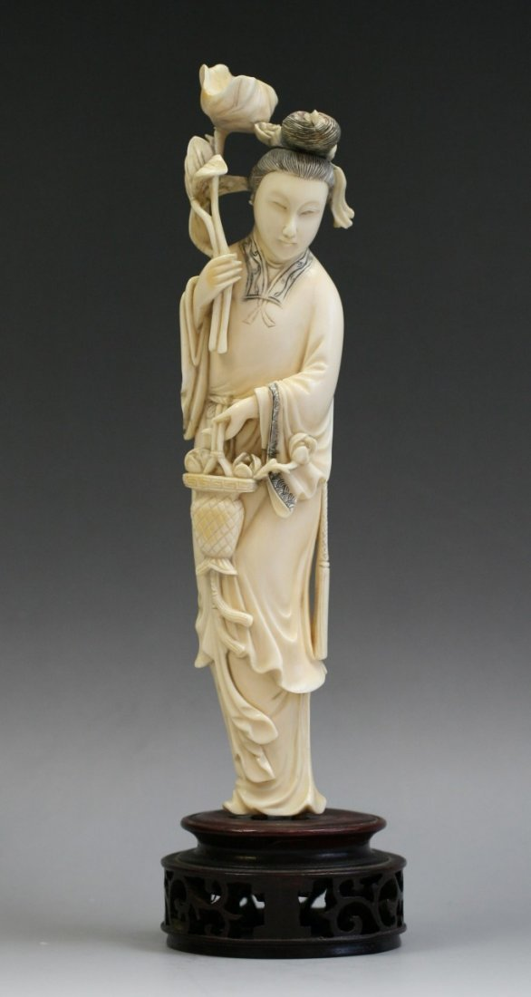 A Chinese Carved Qing Ivory Beauty With Flowers